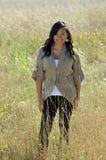 Beautiful young Asian woman - Autumn. Beautiful young Asian woman wearing sweater standing in field Stock Photos