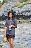 Beautiful young asian woman on beach Stock Image