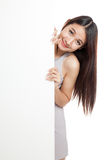 Beautiful young Asian woman with blank sign Royalty Free Stock Photo