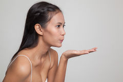 Beautiful young Asian woman blow a kiss. Beautiful young Asian woman blow a kiss  on gray background Royalty Free Stock Photos
