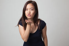 Beautiful young Asian woman blow a kiss. Royalty Free Stock Images