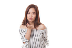 Beautiful young Asian woman blow a kiss. Beautiful young Asian woman blow a kiss isolated on white background Royalty Free Stock Image