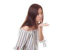 Beautiful young Asian woman blow a kiss. Beautiful young Asian woman blow a kiss isolated on white background Stock Photography