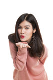 Beautiful young Asian woman blow a kiss. Beautiful young Asian woman blow a kiss isolated on white background Royalty Free Stock Photography