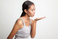 Beautiful young Asian woman blow a kiss. Beautiful young Asian woman blow a kiss on white background Stock Images