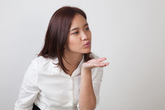 Beautiful young Asian woman blow a kiss. Beautiful young Asian woman blow a kiss on white background Stock Photography