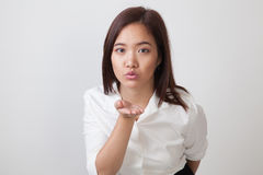 Beautiful young Asian woman blow a kiss. Beautiful young Asian woman blow a kiss on white background Royalty Free Stock Photography