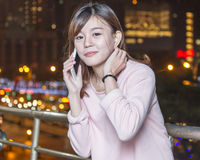 Beautiful young Asian woman with cellphone Royalty Free Stock Photo