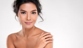 Beautiful Young Asian Woman with Clean Fresh Skin. Look away, Girl beauty face care. Facial treatment, Cosmetology, beauty and spa stock image