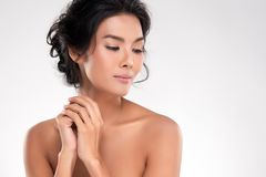 Beautiful Young Asian Woman with Clean Fresh Skin. Look away, Girl beauty face care. Facial treatment, Cosmetology, beauty and spa royalty free stock photos