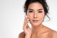 Beautiful Young Asian Woman with Clean Fresh Skin. Look away, Girl beauty face care. Facial treatment, Cosmetology, beauty and spa royalty free stock photography