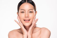 Beautiful Young asian Woman with Clean Fresh Skin. Look. Girl beauty face care. Facial treatment. Cosmetology, beauty and spa royalty free stock photos