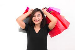 Asian woman with colorful carry shopping bags in her hands smile and happiness. on white background. Royalty Free Stock Photography