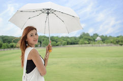Beautiful young Asian woman in the countryside Royalty Free Stock Photography