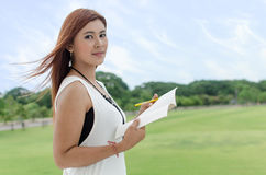 Beautiful young Asian woman in the countryside Royalty Free Stock Image