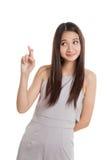 Beautiful young Asian woman cross finger Royalty Free Stock Photo