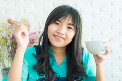 Beautiful young Asian woman with cup of coffee Royalty Free Stock Photo