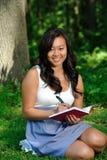 Beautiful young Asian woman - diary Royalty Free Stock Photo