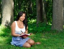 Beautiful young Asian woman - diary Royalty Free Stock Image