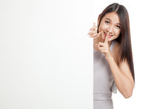 Beautiful young Asian woman do quiet sign with blank sign Stock Photos