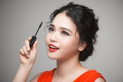 Beautiful Young Asian Woman Doing Makeup Using Mascara On Her Ey Royalty Free Stock Image