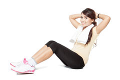 Beautiful young asian woman doing stretching, indoor Royalty Free Stock Image