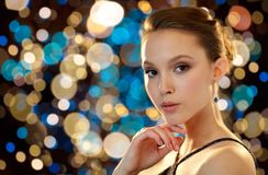Beautiful young asian woman with earring Stock Photo