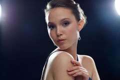 Beautiful young asian woman with earring Royalty Free Stock Images