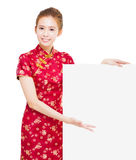 Beautiful young Asian woman with empty billboard Royalty Free Stock Photo
