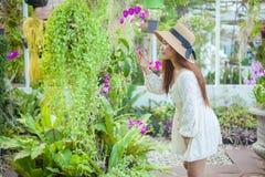 Beautiful young asian woman enjoying the freshness Royalty Free Stock Photos