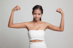 Beautiful young Asian woman flex bicep. Stock Image