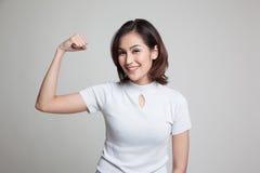 Beautiful young Asian woman flex bicep. Stock Photos