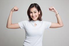 Beautiful young Asian woman flex bicep. Royalty Free Stock Image