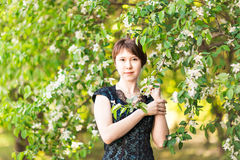 Beautiful young asian woman in flowering spring garden. Royalty Free Stock Photo