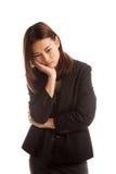 Beautiful young Asian woman get bored. Royalty Free Stock Photos