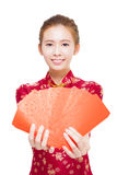 Beautiful young asian woman giving  red bags for rich Royalty Free Stock Photography