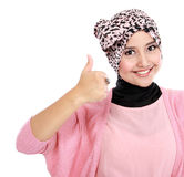 Beautiful young asian woman giving thumbs up Stock Photos