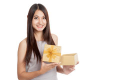 Beautiful young Asian woman with golden gift box Royalty Free Stock Photos