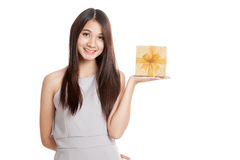 Beautiful young Asian woman with golden gift box Royalty Free Stock Image