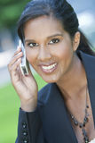 Beautiful Young Asian Woman On Her Cell Phone Royalty Free Stock Image