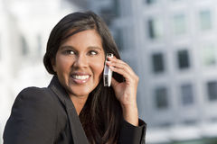 Beautiful Young Asian Woman On Her Cell Phone Royalty Free Stock Images