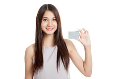 Beautiful young Asian woman hold a blank card Royalty Free Stock Image