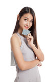 Beautiful young Asian woman hold a blank card Royalty Free Stock Photo