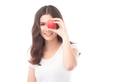 Beautiful young asian woman holding an apple. Stock Photos