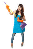 Beautiful young asian woman holding a broom, use it like a guita Stock Images