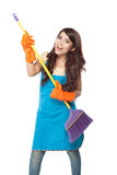 Beautiful young asian woman holding a broom, use it like a guita Royalty Free Stock Photography