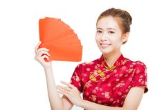 Beautiful young asian woman holding red bag for rich Royalty Free Stock Photography