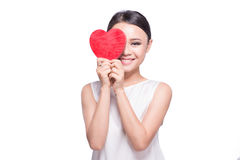 Beautiful young asian woman holding red heart on white.  Stock Photo
