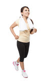 Beautiful young asian woman jogging indoor, isolated royalty free stock photo