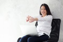 Beautiful young asian woman with laptop stretch and exercise relax after work success. Beautiful young asian woman with laptop stretch and exercise relax after stock image
